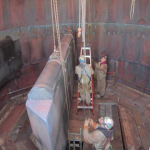 Removing Silencer Baffles using engineered beam and beam trolleys. Panels had to be rigged with slings because of inadequate existing lifting eyes and condition of panels.